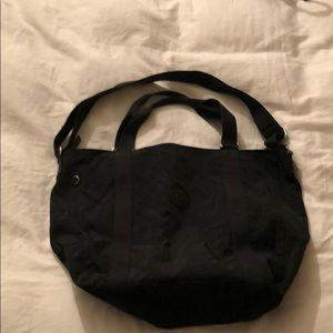 Kipling black duffel bag with cross body strap